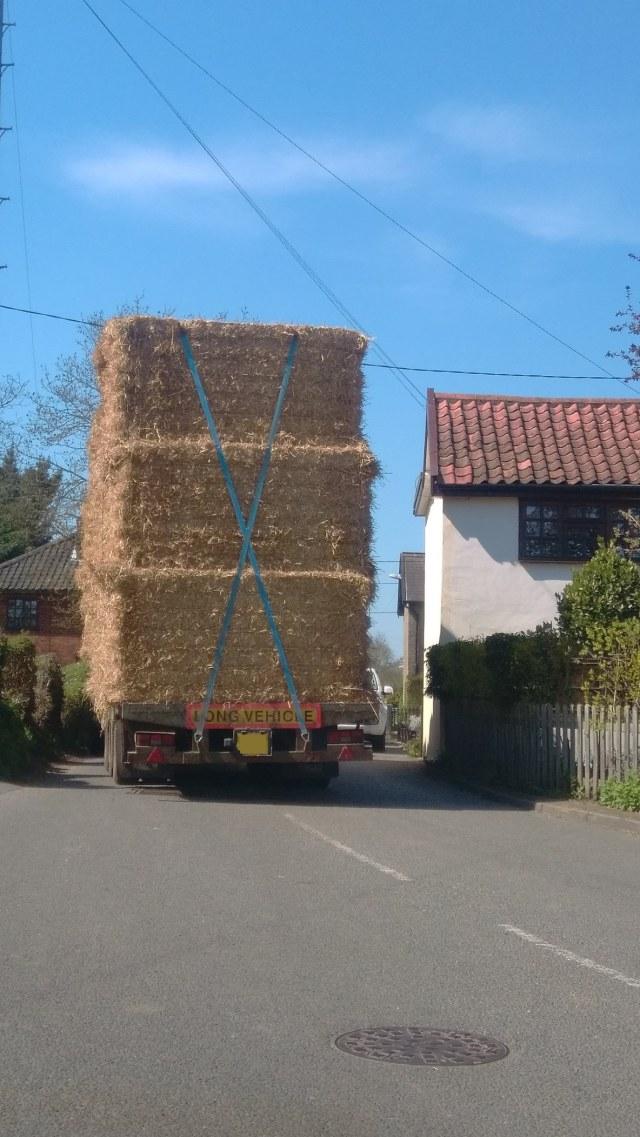 Large Agricultural Vehicle Filling Road